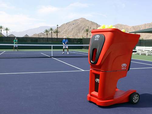 Lobster tennis ball machine on tennis court