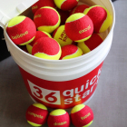 """""""Quick Start 36"""" Red Felt Tennis Balls w/ Slogans - 48 Ball Bucket -"""